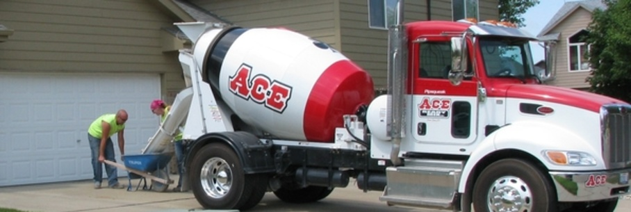 Small cement truck in driveway
